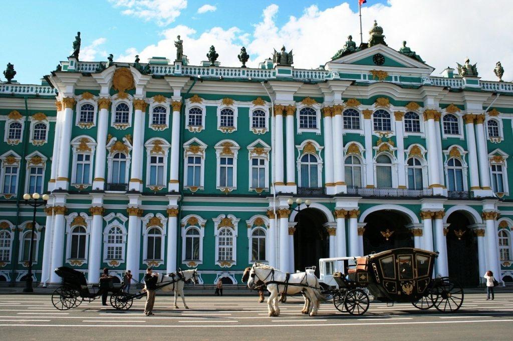 Horses and buggies await outside the Russian Winter Palace