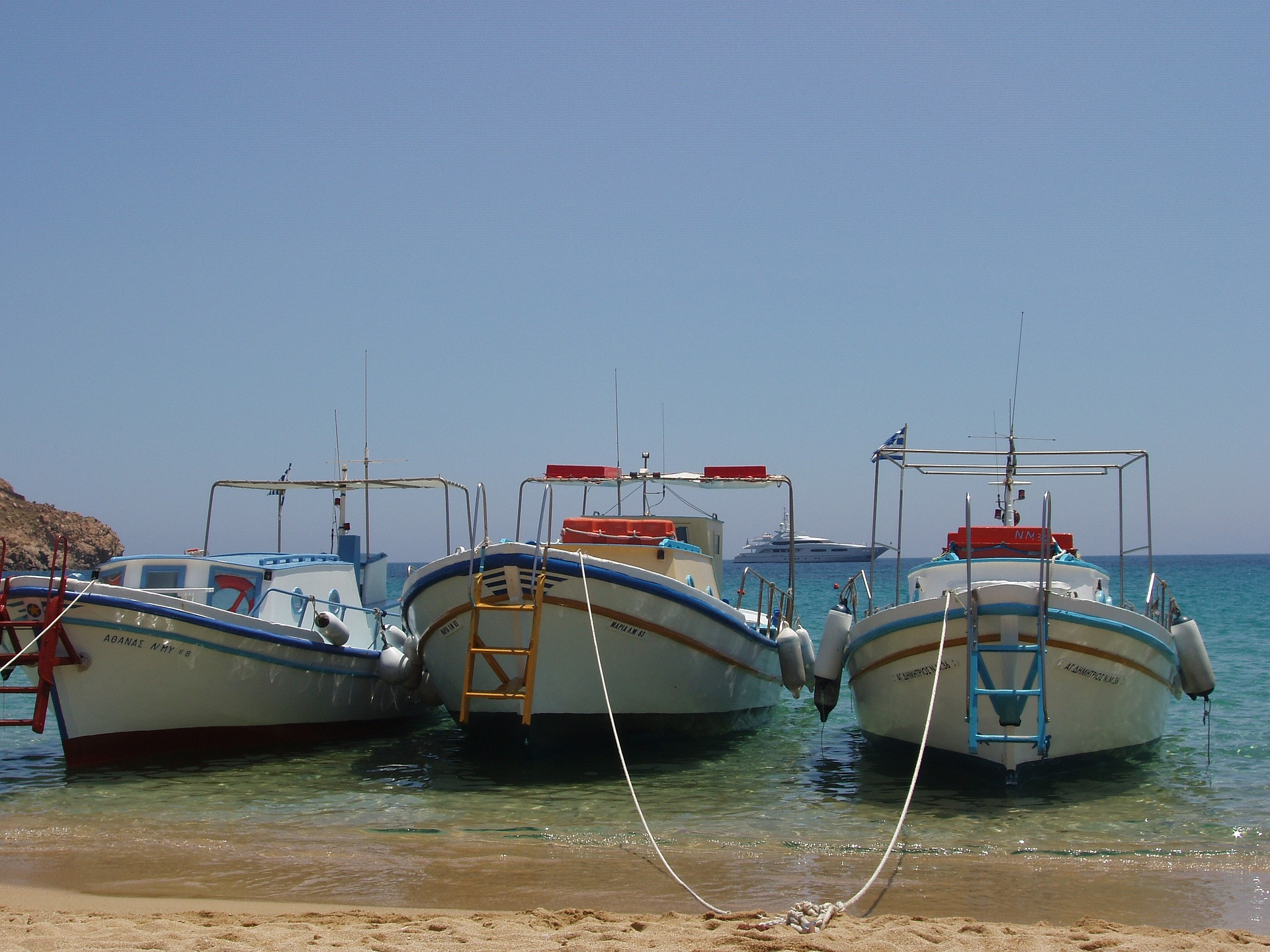 Boats docked on the beach in Mykonos
