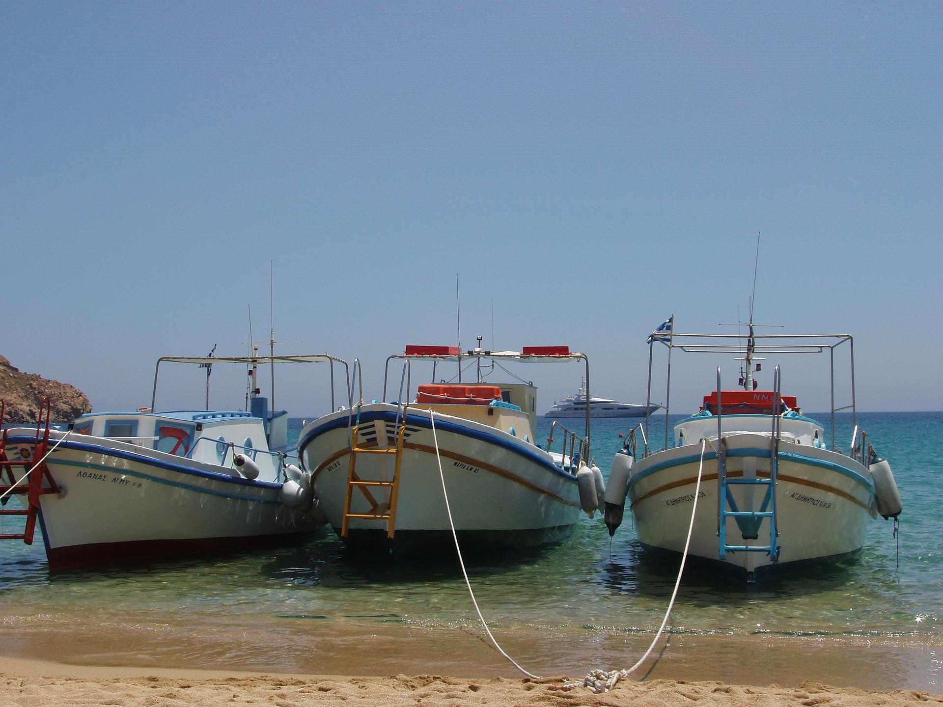 Boats docked on the beach in Mykonos
